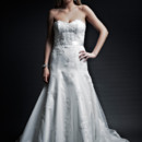 Miriam  Re-Embroidered lace. Modified A-Line gown with cathedral train. Strapless sweetheart neckline bustier. Hand placed re-embroidered lace on bodice and skirt. natural waist is accented with lace applique sash.
