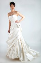 Allison Silky Satin. Full Aline skirt with softly draped bodice and sweetheart neckline. Aline skirt is draped and accented with beaded rose buds, corset back and bubble hem.