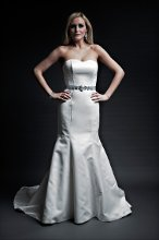 Sarah Soft Satin Trumpet gown with cathedral length train. Strapless slight sweetheart neckline. Covered buttons accent the back.