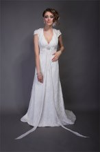 "Style ""Camilla"" Re-embroidered alencon lace. Fit and flair gown with halter neckline, cap sleeve, key hole back and sweep train. Chiffon ribbon detail at empre line accents the gown."