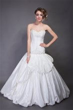 "Style ""Lisandra"" Silk Taffeta. Fit and Flair ball gown with dramatic draped bubble overlay and chapel length bubble hem train. Strapless sweetheart neckline with beading and embroidery accenting the neckline and drop waist."