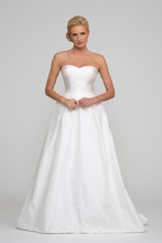 Allysa Silk taffeta. Natural waist ball gown with box pleats and sweep train. Sweetheart neckline and draping accentuate the bodice. Matching bolero available upon request. Available White as sampled, and Ivory.