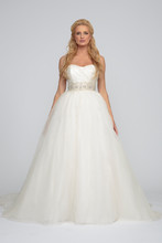 Anne Silk organza. Gathered ball gown with cathedral length train. Sweetheart neckline and draped natural waist organza bodice. Natural waist and train are accented with crystal beading appliques.