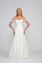 Catherine Silk tulle and Italian Satin. Drop waist modified A-line gown. Sweetheart neckline with beaded crystal straps. Skirt accented with tulle godets and fully beaded bodice with beaded skirt detail.