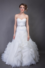 Diane Italian Silk Satin/Organza. Dropped waist A-line gown. Strapless sweetheart neckline bodice with princess seams. Skirt is accented with curved organza strips and ruffle detail. Buttons accent back of bodice.(Sash Sold Separately)