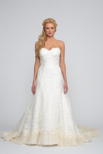Sophia Chantilly Lace. Modified A-line gown with organza pin tucked pleated hem and cathedral length train. Empire waist sweetheart neckline with spaghetti straps and covered buttons over zipper.