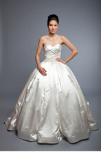 Vanessa BMW Silk Satin. Ball Gown. Sweetheart neckline with natural waist and draped bodice. Skirt has inverted pleats and gown is accented with crystal beading, embroidery, and three dimensional ribbon detail.