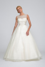 Caroline  Silk Organza. Natural waist gown with full flowing asymmetric pleated skirt and cathedral length train. Organza beaded illusion neckline and bodice with covered buttons.