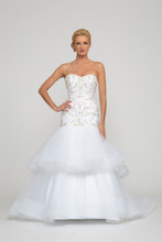 Cassandra  Silk Tulle. Fit to flair gown with layered tulle skirt and horse hair trim and sweep train. Strapless sweetheart neckline and fully beaded crystal and embroidered three dimensional bodice.