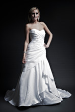 Michelle  Regal Satin. Modified A-Line Gown with chapel train. Strapless dropped waist with draped body and stufted draped front