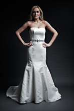 Sarah  Soft Satin.  Trumpet gown with cathedral length train.  Strapless slight sweetheart neckline.  Covered buttons accent the back center seam line.