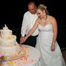 130x130 sq 1352847358066 marinaandahmadcuttingtheweddingcake