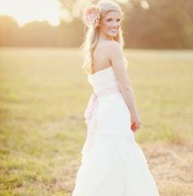 220x220 1350572439241 sellyourweddingdressbride