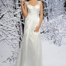 SL016 Beautiful Luster Satin gown with beaded sweetheart neckline and beaded embroidery straps leading to a gorgeous sheer back. The dress is made with princess seam, lightly gathered at the back and finished with a sweep train. Available in White or Ivory.
