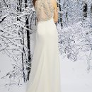 SL019 Grecian Silky Crepe gown made sleeveless with draped neckline. The empire waist and sheer back is heavily embellished with floral accents and beading, leading to a sweep train. Available in White or Ivory.