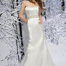 SL022 Royal Duchess Satin strapless sweetheart gown made with princess seam, bedazzled with heavily beaded ribbon belt and finished with a sweep train. Available in White or Ivory. The detachable belt can also be ordered separately. (See BLT037) (Also pictured with belt style BLT030 sold separately.)