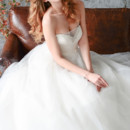 GL037 An exquisite ball gown in Taffeta and Tulle made with a strapless sweetheart bodice fully embellished with beading and finished with a ribbon belt.