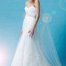 Eden Bridals BL034  Beautiful Silky Dupione gown has a crossover sweetheart neckline, which is embellished heavily.The mermaid skirt is made with an intricate overlay lace that flows to the chapel length train.