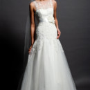 Eden Bridals GL041  A stunning Lace and Tulle gown with a sheer boat neck bodice and floral ribbon belt at the waist.