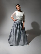 190 White and silver Chantilly lace bodice. Silver silk shantung skirt and beaded waistband.