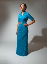 192 Turquoise alencon lace dress with beaded belt that cinches at the waist. Queen Anne neckline and three-quarter sleeves.