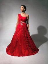 194 Bright red taffeta ballgown with a asymmetrical pleats, one shoulder and crystal beading around waist.