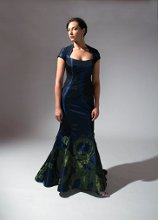 196 Iridescent green taffeta in circular cutouts over tailored iridescent blue taffeta fit-n-flair gown.