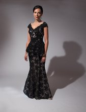 199 Elegant black lace over nude charmeuse. Black lace peplum over hips.