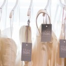 130x130 sq 1416330628733 dresses hanging new tag