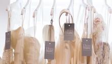 220x220 1416330628733 dresses hanging new tag