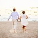 130x130 sq 1448302898928 wedding couple runs on the beach