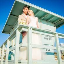220x220 sq 1448302987915 wedding couple on life guard tower