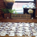 Escort card table. Favors designed and created by family. Tablescape design by Lady Slipper Affairs & Events.
