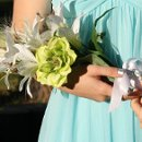 Tropical Beach Arm Bouquet in white and green, Hand tied with White Satin ribbon. Accented with silver jeweled seashell. Price: $35.00