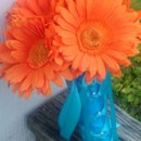130x130 sq 1366525217117 daisy orange bouquet1