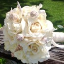 130x130 sq 1373436336522 bouquet shells ivory roses9
