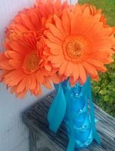 220x220_1368160327587-daisy-orange-bouquet1