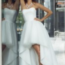 Farrah Strapless, soft sweetheart neckline with a pleated bodice and a high-low hem skirt