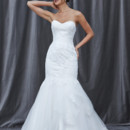 FELICE A classic fit and flare gown with a strapless sweetheart neckline and lace appliques throughout the bodice and sparsely stitched throughout the tulle layered skirt.