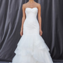 FELICIA A classic fit and flare gown has a pleated tulle bodice, a tiered-gathered tulle skirt with lace appliques sparsely tacked throughout.