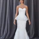FLORENCE A strapless sweetheart neckline, peplum trumpet gown/ Lace appliques throughout the bodice and skirt.