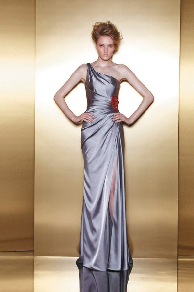 E3  A soft satin sheath gown with an asymmetrical strap and bright floral detail at the hip.