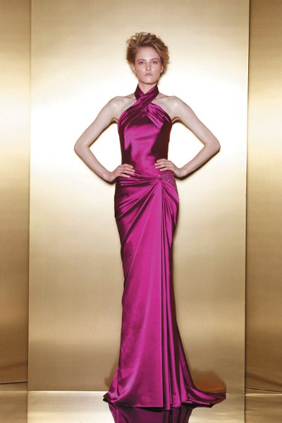 E6  A halter satin sheath that gathers at the hip with embroidered detail.