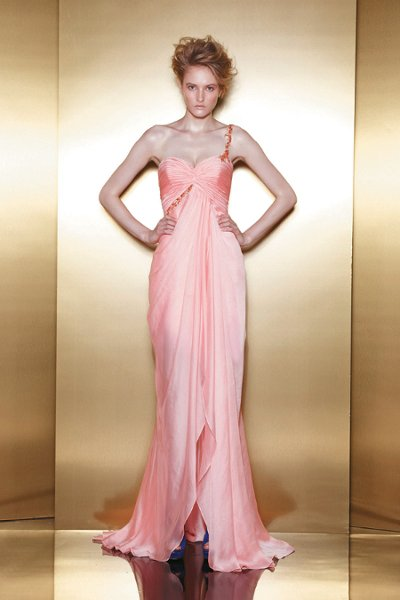 E13 A one-shoulder chiffon sheath gown with a ruched bodice and jewel detail.