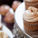 Assorted cupcake flavors served on elegant crystal accented cake stands. Pictured: Banana Cupcake with Banana Rum Buttercream and a Banana Chip