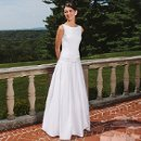 Hannah Sleeveless fitted bodice with drop waist and box pleated skirt in cotton, accented with bow detail.