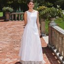 Harper Silk duchess satin sleeveless A-line gown with organza ruffle at hem.