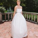 Lucy Strapless fitted bodice with ribbon at high waist and full princess skirt in silk taffeta.