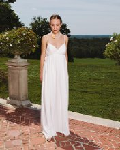 Daisy Chiffon overlay empire waisted gown with spaghetti straps and deep v-neck.