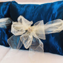 130x130 sq 1482194660028 blue satin pillows with gold sashes